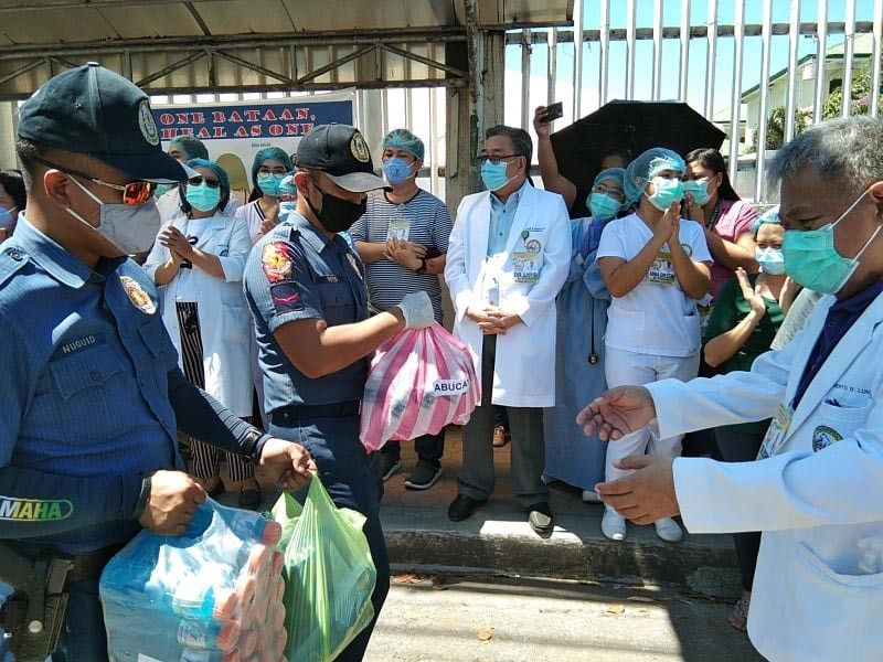 PAMPANGA. As a way of showing their gratitude to their fellow frontliners in the fight against coronavirus disease, Philippine National Police turns over personal protective equipment and other essentials to health workers in Central Luzon. (Contributed photo)