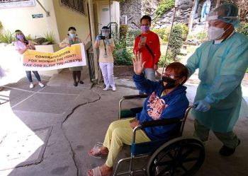 BAGUIO. Milagros Costales, a 73–year-old Covid-19 patient from Baguio recovers from the disease and is discharged Saturday, April 4, 2020 after a team of doctors and nurses from Notre Dame de Chartes Hospital cared for her 24/7 for 15 days. Costales is the fifth Covid graduate from Baguio to go home healthy. (Photo by JJ Landingin)