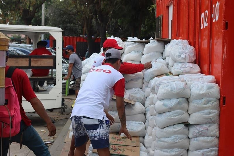 Workers of Angeles City local government prepare food packs for indigent families severely affected by the quarantine.(Contributed photo)