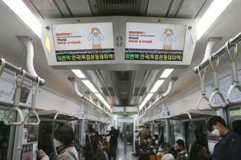 SOUTH KOREA. Electric screens about precautions against the Covid-19 illness are seen in a subway train in Seoul, South Korea, Monday, April 6, 2020. (AP)