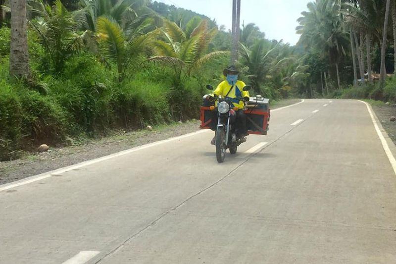 DAVAO. A farmer traversing a completed farm-to-market road in Davao del Sur. (Photo from DA-PRDP website)