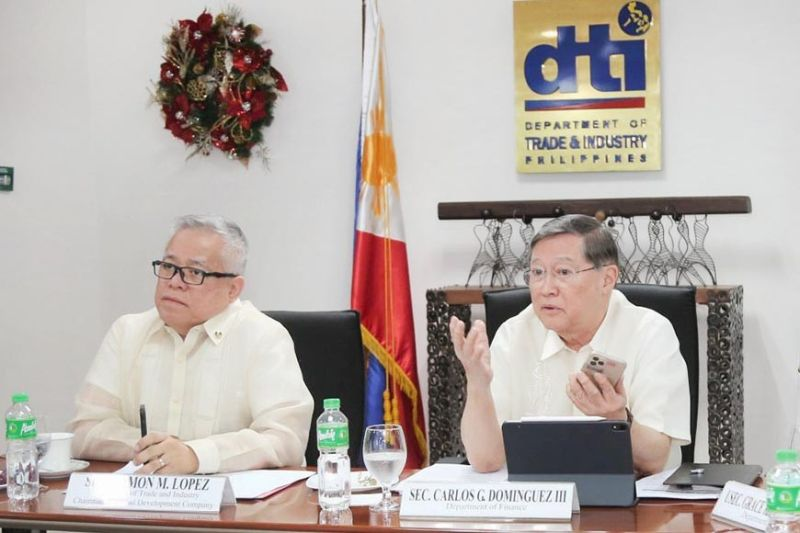From left, Trade Secretary Ramon Lopez and Finance Secretary Carlos Dominguez III say that the importation of materials needed to combat Covid-19 are exempted from import duties, taxes and other fees. (Photo from DTI website)