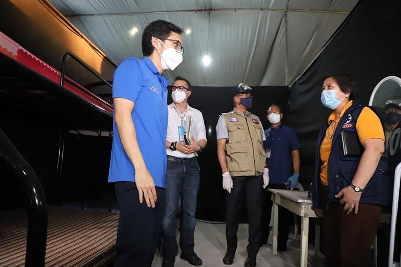 PAMPANGA. National Task Force against Covid-19 members inspect the Philippine Arena complex at Ciudad de Victoria in Bocaue, Bulacan which will initially cater to about 300 coronavirus disease patients who are asymptomatic or have mild/moderate symptoms. (Contributed photo)
