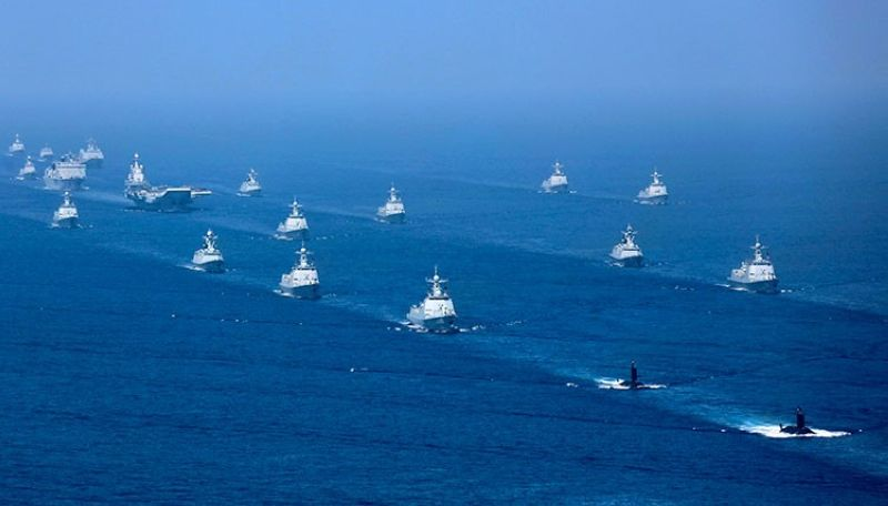 CHINA. In this April 12, 2018, file photo released by China's Xinhua News Agency, the Liaoning aircraft carrier is accompanied by navy frigates and submarines conducting an exercises in the South China Sea. (AP)