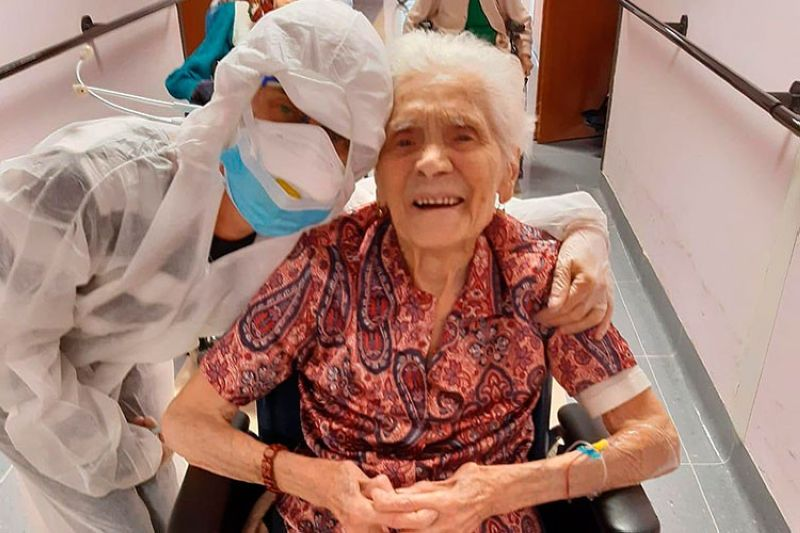 ITALY. In this photo taken on April 1, 2020, 103-year-old Ada Zanusso, poses with a nurse at the old people's home