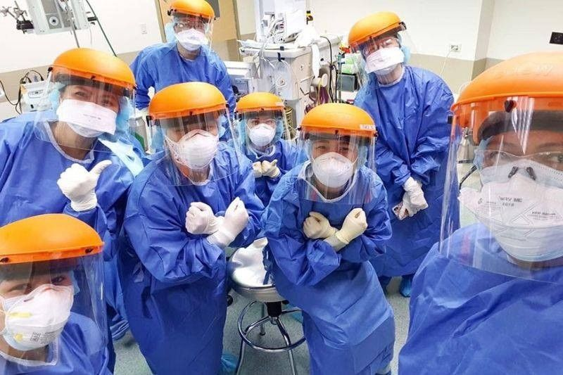 Medical workers in PPE suits (File Photo)