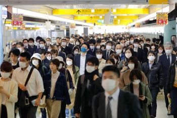 JAPAN. Commuters wear masks at a station in Fukuoka, southern Japan Wednesday morning, April 8, 2020. (AP)