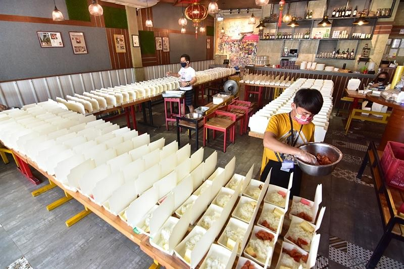 On March 15, Fat Cow prepared 120 food packs for those working at the frontlines. Fast forward to the present, the two restaurants of chef Darence Patrick Co -- Fat Cow and Asian Cow -- are now preparing a total of around 1,200 food packs. In this photo, the crew at Asian Cow prepare meals for their beneficiaries. (Macky Lim)