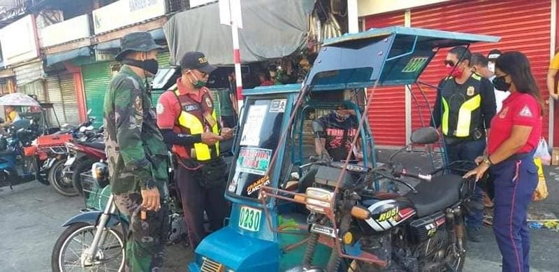 BACOLOD. Tricycles and pedicabs were apprehended by personnel of Bacolod Traffic Authority Office (BTAO) at Libertad area in Bacolod City amid the ongoing enhanced community quarantine. They were issued citation tickets. (Contributed by BCPO)