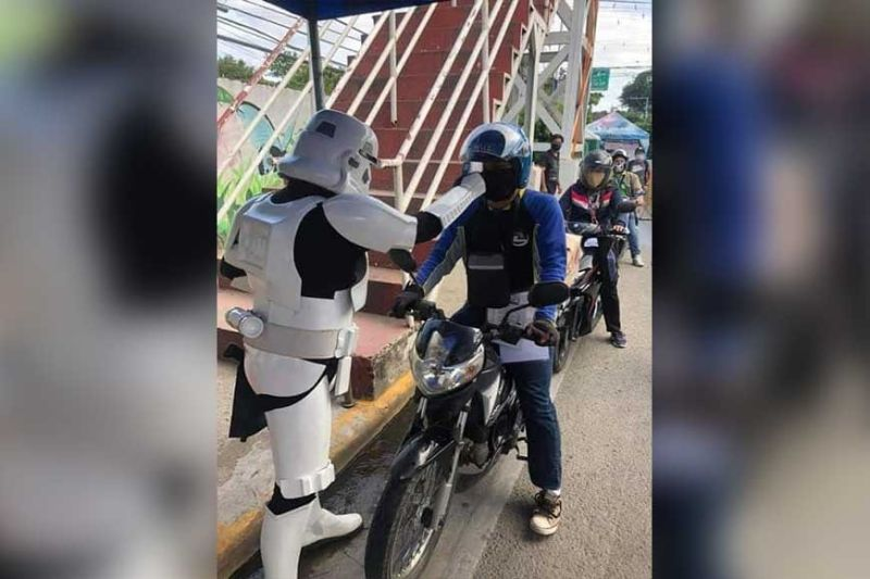 MAY THE FORCE BE WITH YOU. A Cebuano 'stormtrooper' checks the temperature of a motorist plying one of the major roads in Consolacion town in a bid to combat the spread of the coronavirus disease. (Photo courtesy of 501st Cebu Scarif Garrison)