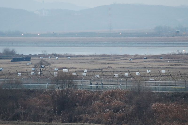 KOREA. In this Dec. 16, 2019, file photo, South Korean army soldiers patrol along the barbed-wire fence in Paju, South Korea, near the border with North Korea. The Joint Chiefs of Staffs in Seoul said that North Korean troops fired several bullets at a South Korean guard post inside the heavily fortified border between the countries on Sunday, May 3, 2020. (AP Photo)