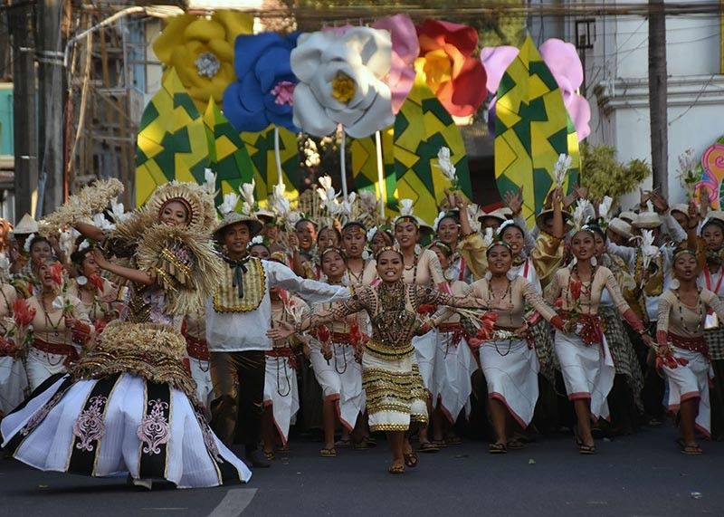 """BAGUIO. In this March 6, 2020 photo, delegates from the different municipalities of Abra in their colorful """"abel"""" costumes perform during the street dancing competition of the 2020 Kawayan Festival in Bangued, Abra. With the Covid-19 pandemic affecting festivals in the region, DOT–CAR is set to bring new guidelines in staging festivals as a new norm. (Photo by Redjie Melvic Cawis)"""