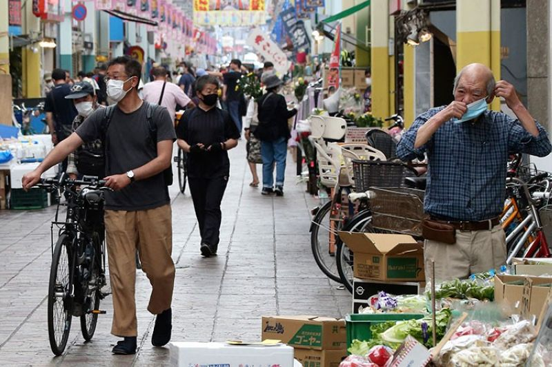 JAPAN. People wearing face masks to protect against the spread of the new coronavirus walk through a shopping area in Yokohama, near Tokyo, Wednesday, May 13, 2020. (AP)