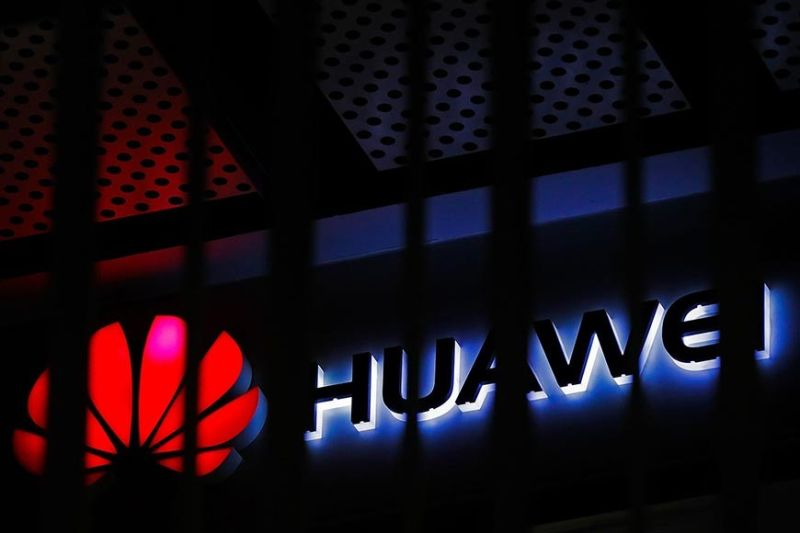 CHINA. In this March 8, 2019, file photo, A logo of Huawei retail shop is seen through a handrail inside a commercial office building in Beijing. The US government is imposing new restrictions on Chinese tech giant Huawei by limiting its ability to use American technology to build its semiconductors. The Commerce Department said Friday, May 15, 2020 the move aims to cut off Huawei's undermining of existing US sanctions. (AP Photo/Andy Wong, File)