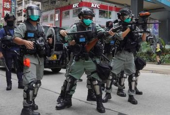HONG KONG. Hong Kong riot police fire tear gas as hundreds of protesters march along a downtown street during a pro-democracy protest against Beijing's national security legislation in Hong Kong, Sunday, May 24, 2020. Hong Kong's pro-democracy camp has sharply criticised China's move to enact national security legislation in the semi-autonomous territory. They say it goes against the