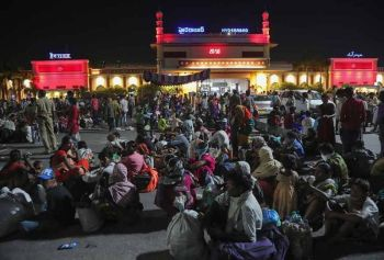 INDIA. Migrant workers line up to board trains to their home states, at Hyderabad Railway Station in Hyderabad, India, Saturday, May 23, 2020. India's lockdown was imposed on March 25 and has been extended several times. On May 4, India eased lockdown rules and allowed migrant workers to travel back to their homes, a decision that has resulted in millions of people being on the move for the last two weeks. (AP)