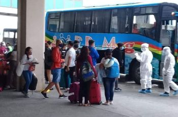 BACOLOD. Seventy-six stranded Negrenses including overseas Filipino workers (OFWs) arrive from Manila yesterday. They were brought to Mambukal Mountain Resort in Murcia town for the 14-day mandatory quarantine. (Richard Malihan Photo)