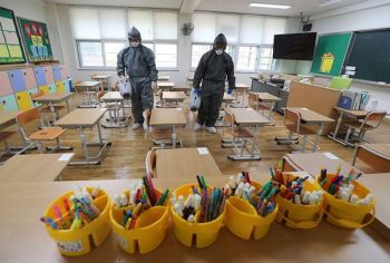 SOUTH KOREA. Workers disinfect as a precaution against the new coronavirus ahead of school reopening in a class at an elementary school in Gwangju, South Korea, Tuesday, May 26, 2020. (AP)
