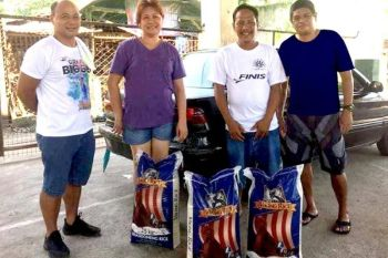 BACOLOD. Negrense swim coaches receive rice and grocery assistance during the quarantine period. (From left) Coaches Buddy Tordillos of Buddy Penguins, Rowena Palomero, representing her husband Ernesto Palomero of Sta. Fe Swim Team; Dennis Manalac of Red Lion Swim Team Kabankalan, and Jigger Abanto of La Salle Stingray. (Cris Bancal Photo)