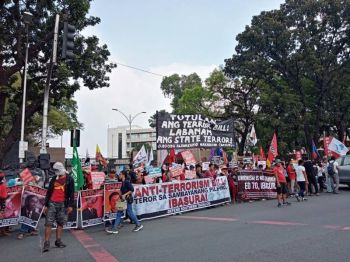MANILA. In this photo taken before Metro Manila was placed under quarantine, protesters gather at the House of Representatives to appeal against a bill similar to Senate Bill 1083, or the proposed Anti-Terrorism Act of 2020. (Photo by Jove T. Moya)