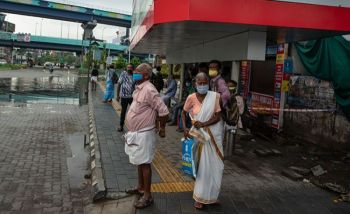 INDIA. People wearing face masks to protect from the new coronavirus as they wait for bus transport in Kochi, Kerala state, India, Monday, June 1, 2020. (AP)
