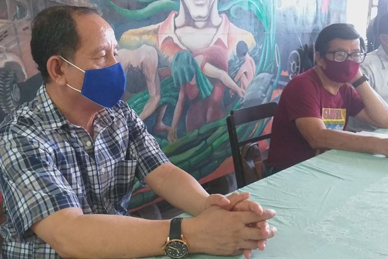 Labor representatives to the Regional Tripartite Wages and Productivity Board in Western Visayas Wennie Sancho (center) and Hernane Braza (left) will push for a wage increase for workers in the region amid the Covid-19 pandemic. (Erwin Nicavera)