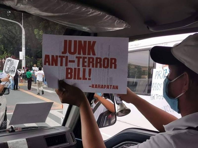 MANILA. In this file photo, a member of rights group Karapatan holds a