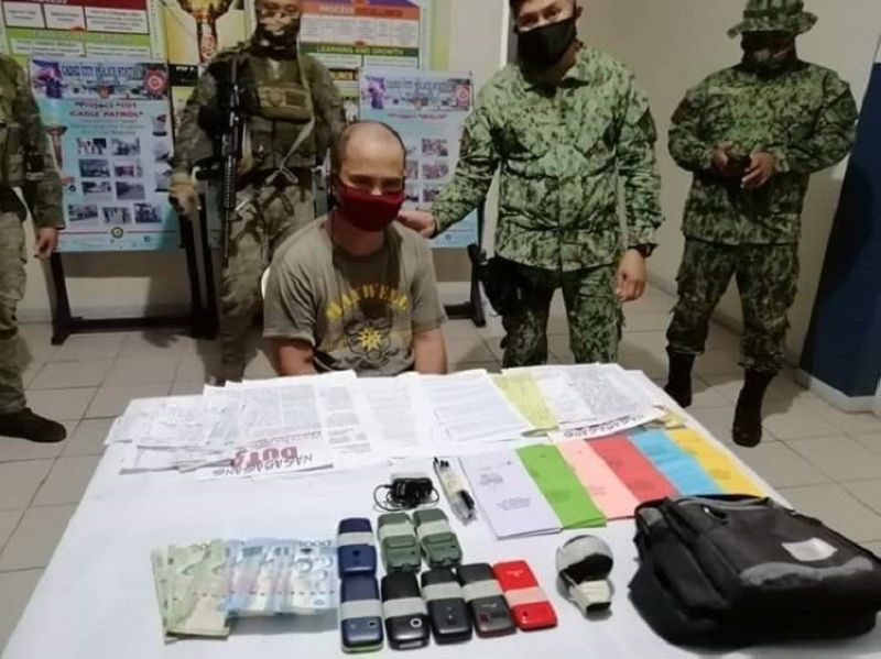 ARREST. Authorities arrest Gaspar Davao alias Aldong, an alleged high-ranking official of the Communist Party of the Philippines-New People's Army (CPP-NPA), for not wearing a face mask in Cadiz City, June 9. (SunStar Bacolod)