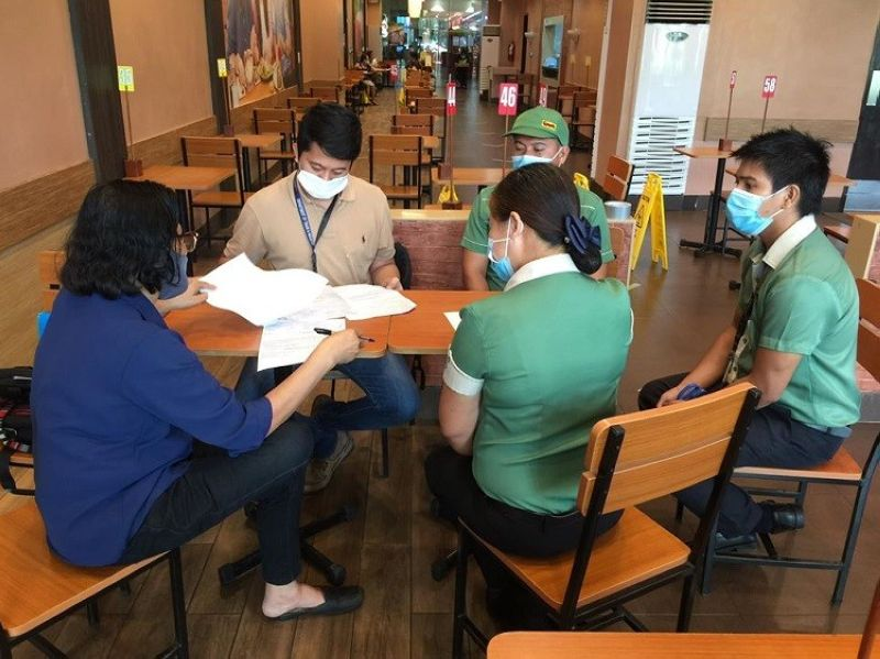 BACOLOD. Personnel of the Department of Trade and Industry – Negros Occidental conduct monitoring of a food establishment inside a mall in Bacolod City if it complies with the safety and health protocols set. (Contributed photo)