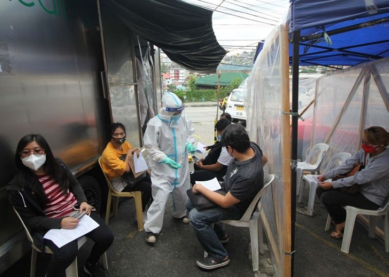DIAGNOSTIC TESTS. Returning workers wait to have chest X-rays taken at the mobile booth setup outside the St. Vincent Gym. Workers who show signs of respiratory illness are referred to have a PCR test to ascertain if they have contracted Covid-19. (Photo by Jean Nicole Cortes)