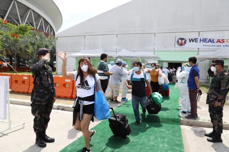 COVID SURVIVORS. A total of 151 overseas Filipino workers were sent home Saturday, June 20, after recovering from Covid-19 at the We Heal As One Center-Philippine Arena. (BCDA)