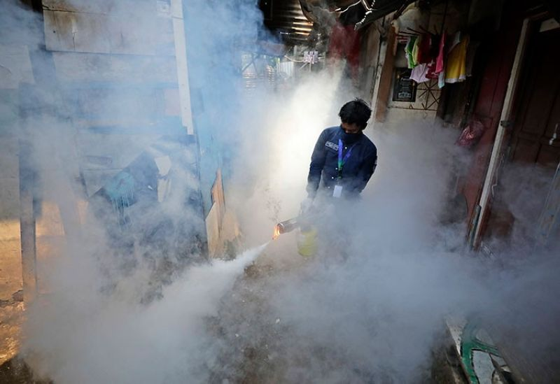 INDONESIA. A worker fumigates a slum to prevent an outbreak of dengue fever in Jakarta, Indonesia, Wednesday, April 22, 2020. (AP)