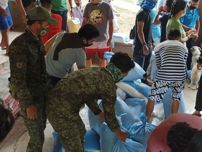 ZAMBOANGA. At least 113 families residing in the far-flung village of Sunop in Dumingag town, Zamboanga del Sur receive a sack of rice each. A photo handout shows 53rd Infantry Battalion troops assisting in the rice distribution. (SunStar Zamboanga)