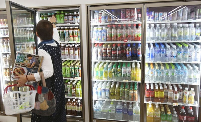 JAPAN. Plastic-bottled soft drinks are displayed in fridges at a store in Yokohama, near Tokyo, June 17, 2019. (AP)