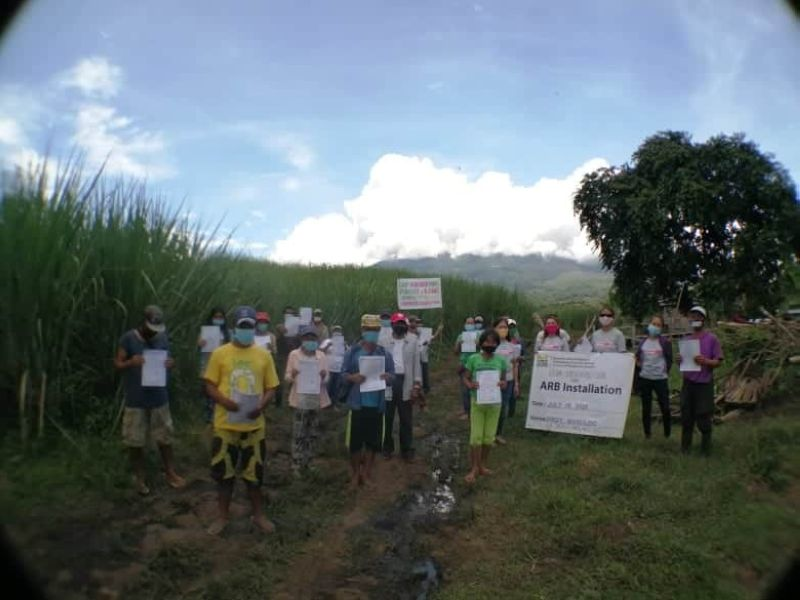 The new landowners together with DAR-Negros Occidental II personnel during the Cloa distribution and installation rites at Barangay Masulog in La Castellana town last week.
