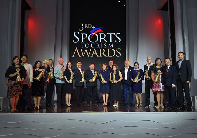 GOING FOR GOLD. The roster of jubilant winners in last year's Philippine Sports Tourism Awards joined by PSTA founder Charles Lim, DOT Undersecretary Benito Bengzon Jr., and Primetime CEO Pauland Dumlao. (Contributed photo)