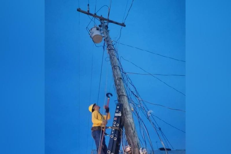 BACOLOD. A worker of the Northern Negros Electric Cooperative conducts line maintenance and operation activity for load monitoring in various areas in  Cadiz City. The cooperative announced a negligible drop in its power rate this month. (Contributed photo)