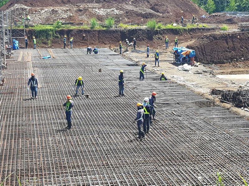 DAVAO. Workers practice social distancing while doing the rebar installation of the project's Powerhouse. (Contributed photo)