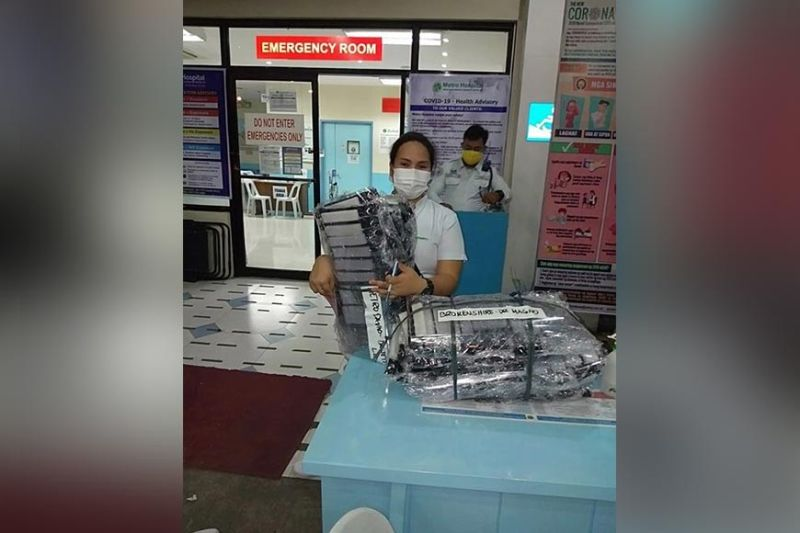 DAVAO. A medical frontliner in Brokenshire Hospital receives face shield from NCCC Cares. (Contributed Photo)