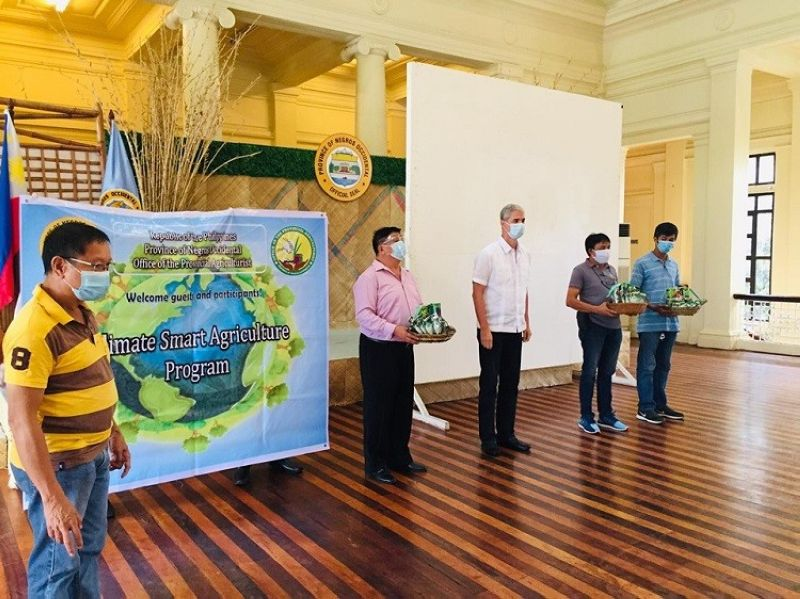 BACOLOD. Governor Eugenio Jose Lacson (center) and Provincial Agriculturist Japhet Masculino (left) lead the turnover of farm inputs to various farmer associations representatives at the Provincial Capitol's Social Hall in Bacolod City Wednesday, July 29, 2020. (Contributed Photo)