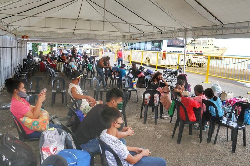 GOING HOME. Locally stranded individuals who arrived in Cebu Sunday morning, Aug. 2, 2020, wait for their ride home at the Aduana port behind the Malacañang sa Sugbo. (Amper Campaña)