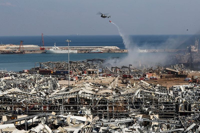 LEBANON. A Lebanese army helicopter throw water at the scene where an explosion hit the seaport of Beirut, Lebanon, Wednesday, August 5, 2020. (AP)