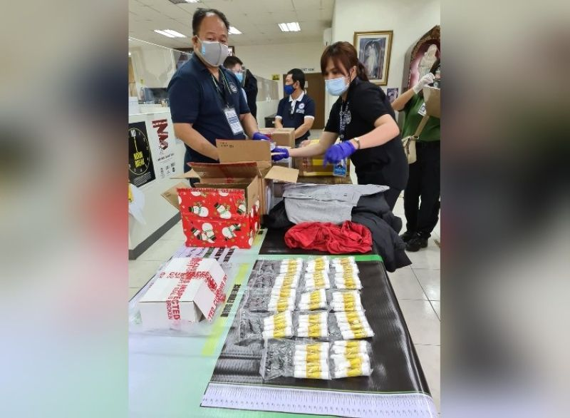 ILLEGAL DRUGS. Bureau of Customs Port of Clark personnel sort out the intercepted P2.2 million worth of marijuana, kush, CBD oil and other illegal drugs coming from other countries and being shipped to Clark. (Photo by Chris Navarro)