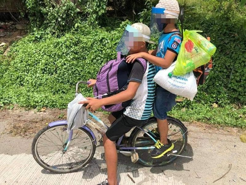 LONG RIDE. Two children attempt to bike their way from Nabunturan, Davao de Oro to Panabo City, Davao del Norte, which is around 56 kilometers, in an attempt to run away from their relatives and return to their grandfather. (MDRRMO Mawab)