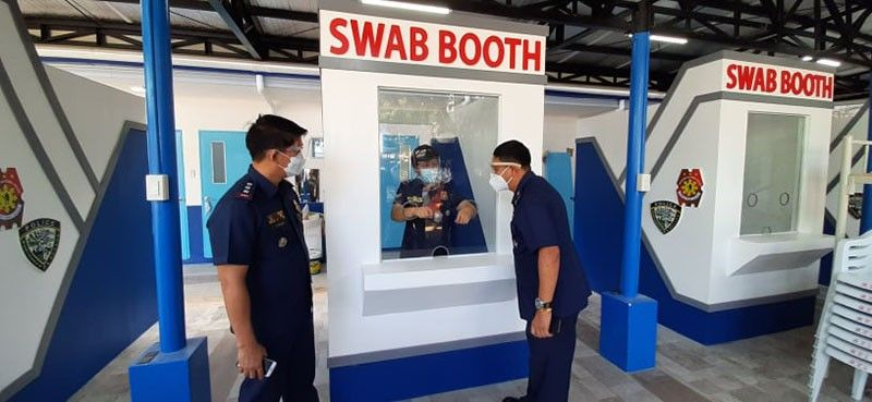 DIAGNOSTICS. Police Regional Office 7 Director Albert Ignatius Ferro (right) inspects the swab booth that is part of the new Covid-19 molecular diagnostics laboratory in Camp Sotero Cabahug. With him are Police Col. Josefino Ligan and Police Lt. Col. Marilou Aboloc. / CONTRIBUTED