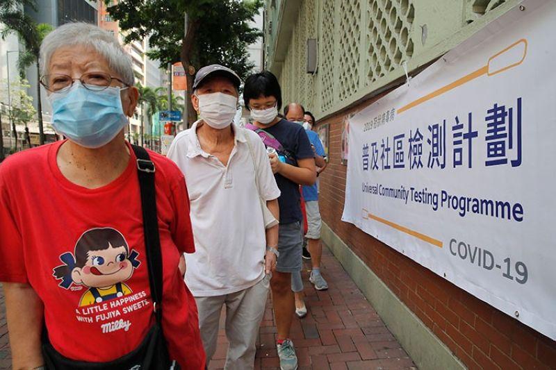 HONG KONG. People wearing face masks queue for the coronavirus test outside a testing center in Hong Kong, Tuesday, September 1, 2020. (AP)
