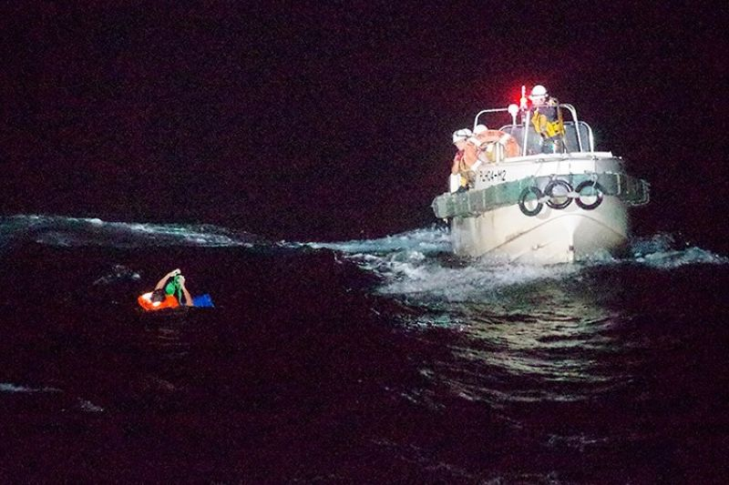 JAPAN. In this photo released by the 10th Regional Japan Coast Guard Headquarters, a Filipino crewmember of a Panamanian cargo ship is rescued by Japanese Coast Guard members in the waters off the Amami Oshima, Japan Wednesday, September 2, 2020. (AP)