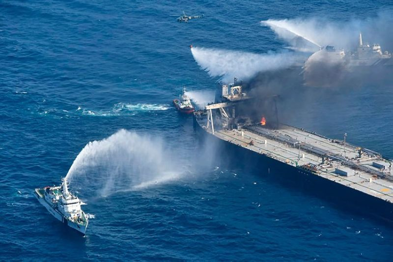 SRI LANKA. In this photo provided by Sri Lanka Air Force, tug boats and ships battle the fire on MT New Diamond, off the eastern coast of Sri Lanka in the Indian Ocean, Saturday, September 5, 2020. (AP)