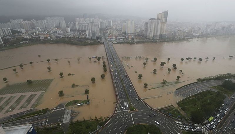 SOUTH KOREA. A part of a road and riverside near the Taehwa River are  flooded due to heavy rain in Ulsan, South Korea, Monday, September 7, 2020. (AP)