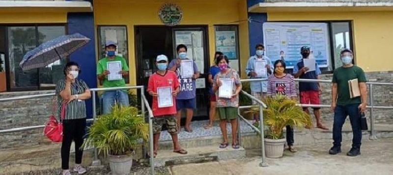 VICTORIAS. Agrarian reform beneficiaries in Victorias City receive their certificates of land ownership award from the Department of Agrarian Reform - Negros Occidental I recently. (Contributed Photo)